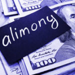 Sign that says alimony laying across money