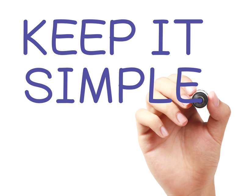 """Person's hand writing """"Keep It Simple"""""""